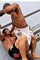 RIO DE JANEIRO, BRAZIL - JANUARY 14:  Yuri Alcantara (Top) punches on top of Michihiro Omigawa (Bottom) in a featherweight bout during UFC 142 at HSBC Arena on January 14, 2012 in Rio de Janeiro, Brazil.  (Photo by Josh Hedges/Zuffa LLC/Zuffa LLC via Getty Images)