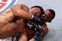 RIO DE JANEIRO, BRAZIL - JANUARY 14:  Yuri Alcantara (Bottom) chokes Michihiro Omigawa (Top) in a featherweight bout during UFC 142 at HSBC Arena on January 14, 2012 in Rio de Janeiro, Brazil.  (Photo by Josh Hedges/Zuffa LLC/Zuffa LLC via Getty Images)