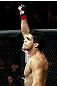 RIO DE JANEIRO, BRAZIL - JANUARY 14:  Thiago Tavares reacts against Sam Stout in a lightweight bout during UFC 142 at HSBC Arena on January 14, 2012 in Rio de Janeiro, Brazil.  (Photo by Josh Hedges/Zuffa LLC/Zuffa LLC via Getty Images)