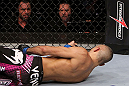 RIO DE JANEIRO, BRAZIL - JANUARY 14: Commentators Mike Goldberg (Top Right) and Joe Rogan (Top Left) look on as Terry Etim (Bottom) lays knocked out after being kicked by Edson Barboza (not pictured) with a spinning back kick in a lightweight bout during UFC 142 at HSBC Arena on January 14, 2012 in Rio de Janeiro, Brazil.  (Photo by Josh Hedges/Zuffa LLC/Zuffa LLC via Getty Images)