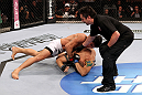 RIO DE JANEIRO, BRAZIL - JANUARY 14:  Erick Silva (Top) punches Carlo Prater as referee Mario Yamasaki (R) calls the welterweight bout during UFC 142 at HSBC Arena on January 14, 2012 in Rio de Janeiro, Brazil.  (Photo by Josh Hedges/Zuffa LLC/Zuffa LLC via Getty Images)