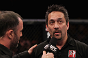 RIO DE JANEIRO, BRAZIL - JANUARY 14:  Referee Mario Yamasaki (R) explains his decision for calling the welterweight bout between Erick Silva and Carlo Prater during UFC 142 at HSBC Arena on January 14, 2012 in Rio de Janeiro, Brazil.  (Photo by Josh Hedges/Zuffa LLC/Zuffa LLC via Getty Images)