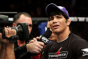 RIO DE JANEIRO, BRAZIL - JANUARY 14:  Erick Silva (R) reacts to referee Mario Yamasaki (not pictured) decision for calling the welterweight bout in favor of Carlo Prater during UFC 142 at HSBC Arena on January 14, 2012 in Rio de Janeiro, Brazil.  (Photo by Josh Hedges/Zuffa LLC/Zuffa LLC via Getty Images)