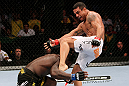 RIO DE JANEIRO, BRAZIL - JANUARY 14:  Vitor Belfort (R) kicks Anthony Johnson (L) in a middleweight bout during UFC 142 at HSBC Arena on January 14, 2012 in Rio de Janeiro, Brazil.  (Photo by Josh Hedges/Zuffa LLC/Zuffa LLC via Getty Images)