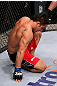 RIO DE JANEIRO, BRAZIL - JANUARY 14:  Chad Mendes tries to get up after losing to Jose Aldo in a featherweight bout during UFC 142 at HSBC Arena on January 14, 2012 in Rio de Janeiro, Brazil.  (Photo by Josh Hedges/Zuffa LLC/Zuffa LLC via Getty Images)