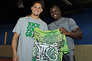 NASHVILLE, TN - JANUARY 18:  (L-R) Tennessee Titans defensive back Cortland Finnegan meets UFC fighter Melvin Guillard during the UFC on FX open workouts at the Nashville MMA Gym on January 18, 2012 in Nashville, Tennessee.  (Photo by Josh Hedges/Zuffa LLC/Zuffa LLC via Getty Images)