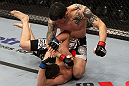 NASHVILLE, TN - JANUARY 20:  (R-L) Daniel Pineda punches Pat Schilling during the UFC on FX event at Bridgestone Arena on January 20, 2012 in Nashville, Tennessee.  (Photo by Josh Hedges/Zuffa LLC/Zuffa LLC via Getty Images)