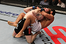 NASHVILLE, TN - JANUARY 20:  (R-L) Fabricio Camoes secures a rear choke submission against Tommy Hayden during the UFC on FX event at Bridgestone Arena on January 20, 2012 in Nashville, Tennessee.  (Photo by Josh Hedges/Zuffa LLC/Zuffa LLC via Getty Images)