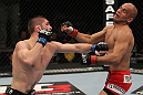 NASHVILLE, TN - JANUARY 20:  (L-R) Khabib Nurmagomedov punches Kamal Shalorus during the UFC on FX event at Bridgestone Arena on January 20, 2012 in Nashville, Tennessee.  (Photo by Josh Hedges/Zuffa LLC/Zuffa LLC via Getty Images)