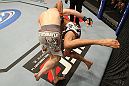 NASHVILLE, TN - JANUARY 20: (L-R) Eric Schafer takes down Jorge Rivera during the UFC on FX event at Bridgestone Arena on January 20, 2012 in Nashville, Tennessee. (Photo by Josh Hedges/Zuffa LLC/Zuffa LLC via Getty Images)