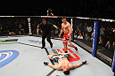 NASHVILLE, TN - JANUARY 20:  Pat Barry (red shorts) reacts after knocking out Christian Morecraft during the UFC on FX event at Bridgestone Arena on January 20, 2012 in Nashville, Tennessee.  (Photo by Josh Hedges/Zuffa LLC/Zuffa LLC via Getty Images)