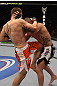 NASHVILLE, TN - JANUARY 20: (L-R) Duane Ludwig delivers a knee strike against Josh Neer during the UFC on FX event at Bridgestone Arena on January 20, 2012 in Nashville, Tennessee.  (Photo by Josh Hedges/Zuffa LLC/Zuffa LLC via Getty Images)