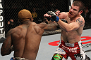 NASHVILLE, TN - JANUARY 20:  (L-R) Melvin Guillard punches Jim Miller during the UFC on FX event at Bridgestone Arena on January 20, 2012 in Nashville, Tennessee.  (Photo by Josh Hedges/Zuffa LLC/Zuffa LLC via Getty Images)