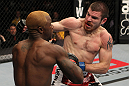 NASHVILLE, TN - JANUARY 20:  (R-L) Jim Miller punches Melvin Guillard during the UFC on FX event at Bridgestone Arena on January 20, 2012 in Nashville, Tennessee.  (Photo by Josh Hedges/Zuffa LLC/Zuffa LLC via Getty Images)