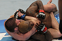 NASHVILLE, TN - JANUARY 20:  (L-R) Jim Miller secures a rear choke submission to defeat Melvin Guillard during the UFC on FX event at Bridgestone Arena on January 20, 2012 in Nashville, Tennessee.  (Photo by Josh Hedges/Zuffa LLC/Zuffa LLC via Getty Images)