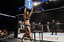 NASHVILLE, TN - JANUARY 20:  UFC Octagon Girl Arianny Celeste introduces round one before the Brenneman vs Roberts bout during the UFC on FX event at Bridgestone Arena on January 20, 2012 in Nashville, Tennessee.  (Photo by Josh Hedges/Zuffa LLC/Zuffa LLC via Getty Images)
