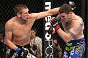 CHICAGO, IL - JANUARY 28:  (L-R) Dustin Jacoby punches Chris Camozzi during the UFC on FOX event at United Center on January 28, 2012 in Chicago, Illinois.  (Photo by Nick Laham/Zuffa LLC/Zuffa LLC via Getty Images) *** Local Caption *** Chris Camozzi; Dustin Jacoby