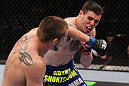CHICAGO, IL - JANUARY 28:  (L-R) Dustin Jacoby and Chris Camozzi trade punches during the UFC on FOX event at United Center on January 28, 2012 in Chicago, Illinois.  (Photo by Nick Laham/Zuffa LLC/Zuffa LLC via Getty Images) *** Local Caption *** Chris Camozzi; Dustin Jacoby