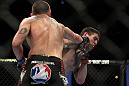 CHICAGO, IL - JANUARY 28:  (L-R) Dustin Jacoby punches Chris Camozzi during the UFC on FOX event at United Center on January 28, 2012 in Chicago, Illinois.  (Photo by Josh Hedges/Zuffa LLC/Zuffa LLC via Getty Images) *** Local Caption *** Chris Camozzi; Dustin Jacoby