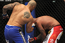 CHICAGO, IL - JANUARY 28:  (L-R) Lavar Johnson punches Joey Beltran during the UFC on FOX event at United Center on January 28, 2012 in Chicago, Illinois.  (Photo by Josh Hedges/Zuffa LLC/Zuffa LLC via Getty Images) *** Local Caption *** Lavar Johnson; Joey Beltran