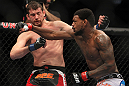 CHICAGO, IL - JANUARY 28:  (R-L) Michael Johnson and Shane Roller trade punches during the UFC on FOX event at United Center on January 28, 2012 in Chicago, Illinois.  (Photo by Josh Hedges/Zuffa LLC/Zuffa LLC via Getty Images) *** Local Caption *** Michael Johnson; Shane Roller