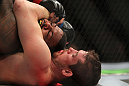 CHICAGO, IL - JANUARY 28:  (R-L) Shane Roller attempts a rear choke submission against Michael Johnson during the UFC on FOX event at United Center on January 28, 2012 in Chicago, Illinois.  (Photo by Josh Hedges/Zuffa LLC/Zuffa LLC via Getty Images) *** Local Caption *** Michael Johnson; Shane Roller