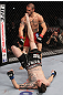CHICAGO, IL - JANUARY 28:  George Roop kicks up at Cub Swanson from the bottom during the UFC on FOX event at United Center on January 28, 2012 in Chicago, Illinois.  (Photo by Nick Laham/Zuffa LLC/Zuffa LLC via Getty Images) *** Local Caption *** Cub Swanson; George Roop