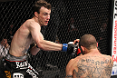 CHICAGO, IL - JANUARY 28:  (L-R) George Roop punches Cub Swanson from the bottom during the UFC on FOX event at United Center on January 28, 2012 in Chicago, Illinois.  (Photo by Nick Laham/Zuffa LLC/Zuffa LLC via Getty Images) *** Local Caption *** Cub Swanson; George Roop