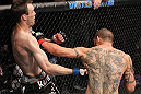 CHICAGO, IL - JANUARY 28:  (L-R) George Roop and Cub Swanson trade punches during the UFC on FOX event at United Center on January 28, 2012 in Chicago, Illinois.  (Photo by Nick Laham/Zuffa LLC/Zuffa LLC via Getty Images) *** Local Caption *** Cub Swanson; George Roop