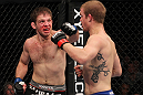 CHICAGO, IL - JANUARY 28:  (L-R) Nik Lentz punches Evan Dunham during the UFC on FOX event at United Center on January 28, 2012 in Chicago, Illinois.  (Photo by Nick Laham/Zuffa LLC/Zuffa LLC via Getty Images) *** Local Caption *** Nik Lentz; Evan Dunham