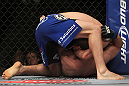 CHICAGO, IL - JANUARY 28:  Evan Dunham (blue shorts) attempts a guillotine choke submission against Nik Lentz during the UFC on FOX event at United Center on January 28, 2012 in Chicago, Illinois.  (Photo by Josh Hedges/Zuffa LLC/Zuffa LLC via Getty Images) *** Local Caption *** Evan Dunham; Nik Lentz