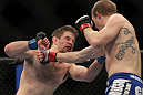 CHICAGO, IL - JANUARY 28:  (R-L) Evan Dunham punches Nik Lentz during the UFC on FOX event at United Center on January 28, 2012 in Chicago, Illinois.  (Photo by Josh Hedges/Zuffa LLC/Zuffa LLC via Getty Images) *** Local Caption *** Nik Lentz; Evan Dunham