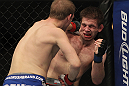 CHICAGO, IL - JANUARY 28:  (L-R) Evan Dunham punches Nik Lentz during the UFC on FOX event at United Center on January 28, 2012 in Chicago, Illinois.  (Photo by Josh Hedges/Zuffa LLC/Zuffa LLC via Getty Images) *** Local Caption *** Nik Lentz; Evan Dunham