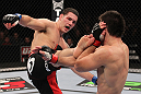 CHICAGO, IL - JANUARY 28:  (L-R) Chris Weidman kicks Demian Maia during the UFC on FOX event at United Center on January 28, 2012 in Chicago, Illinois.  (Photo by Nick Laham/Zuffa LLC/Zuffa LLC via Getty Images) *** Local Caption *** Chris Weidman; Demian Maia