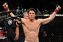 CHICAGO, IL - JANUARY 28:  Chael Sonnen stands in the Octagon before his bout against Michael Bisping during the UFC on FOX event at United Center on January 28, 2012 in Chicago, Illinois.  (Photo by Josh Hedges/Zuffa LLC/Zuffa LLC via Getty Images) *** Local Caption *** Chael Sonnen