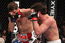 CHICAGO, IL - JANUARY 28:  (R-L) Chael Sonnen punches Michael Bisping during the UFC on FOX event at United Center on January 28, 2012 in Chicago, Illinois.  (Photo by Nick Laham/Zuffa LLC/Zuffa LLC via Getty Images) *** Local Caption *** Chael Sonnen; Michael Bisping