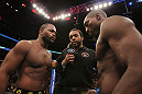 CHICAGO, IL - JANUARY 28:  (L-R) Light Heavyweight opponents Rashad Evans and Phil Davis receive final instructions from referee Herb Dean before their bout during the UFC on FOX event at United Center on January 28, 2012 in Chicago, Illinois.  (Photo by Josh Hedges/Zuffa LLC/Zuffa LLC via Getty Images) *** Local Caption *** Rashad Evans; Phil Davis; Herb Dean