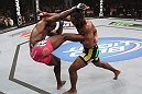 CHICAGO, IL - JANUARY 28:  (R-L) Rashad Evans punches Phil Davis during the UFC on FOX event at United Center on January 28, 2012 in Chicago, Illinois.  (Photo by Nick Laham/Zuffa LLC/Zuffa LLC via Getty Images) *** Local Caption *** Rashad Evans; Phil Davis