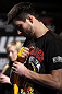 LAS VEGAS, NV - FEBRUARY 01:  Carlos Condit wraps his hands before working out for the media and fans during the UFC 143 open workouts at Mandalay Bay Events Center on February 1, 2012 in Las Vegas, United States.  (Photo by Josh Hedges/Zuffa LLC/Zuffa LLC via Getty Images) *** Local Caption *** Carlos Condit