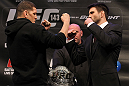 LAS VEGAS, NV - FEBRUARY 02:  (L-R) Opponents Nick Diaz and Carlos Condit face off during the UFC 143 final pre-fight press conference at the Mandalay Bay Hotel &amp; Casino on February 2, 2012 in Las Vegas, United States.  (Photo by Josh Hedges/Zuffa LLC/Zuffa LLC via Getty Images) *** Local Caption *** Nick Diaz; Carlos Condit