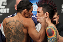 LAS VEGAS, NV - FEBRUARY 03:  (L-R) Bantamweight opponents Renan Barao and Scott Jorgensen face off after weighing in during the UFC 143 official weigh in at Mandalay Bay Events Center on February 3, 2012 in Las Vegas, Nevada.|2:55:8  (Photo by Josh Hedges/Zuffa LLC/Zuffa LLC via Getty Images) *** Local Caption *** Renan Barao; Scott Jorgensen