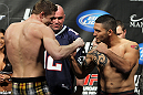 LAS VEGAS, NV - FEBRUARY 03:  (L-R) Welterweight opponents Matthew Riddle and Henry Martinez face off after weighing in during the UFC 143 official weigh in at Mandalay Bay Events Center on February 3, 2012 in Las Vegas, Nevada.|2:55:8  (Photo by Josh Hedges/Zuffa LLC/Zuffa LLC via Getty Images) *** Local Caption *** Matthew Riddle; Henry Martinez