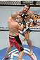LAS VEGAS, NV - FEBRUARY 04:  Matt Brown (white shorts) and Chris Cope (red/black shorts) exchange punches during the UFC 143 event at Mandalay Bay Events Center on February 4, 2012 in Las Vegas, Nevada.  (Photo by Josh Hedges/Zuffa LLC/Zuffa LLC via Getty Images) *** Local Caption *** Matt Brown; Chris Cope