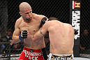 LAS VEGAS, NV - FEBRUARY 04:  Chris Cope (red shorts) punches Matt Brown during the UFC 143 event at Mandalay Bay Events Center on February 4, 2012 in Las Vegas, Nevada.  (Photo by Nick Laham/Zuffa LLC/Zuffa LLC via Getty Images) *** Local Caption *** Chris Cope