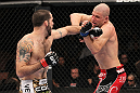 LAS VEGAS, NV - FEBRUARY 04:  Matt Brown (left) punches Chris Cope during the UFC 143 event at Mandalay Bay Events Center on February 4, 2012 in Las Vegas, Nevada.  (Photo by Nick Laham/Zuffa LLC/Zuffa LLC via Getty Images) *** Local Caption *** Matt Brown