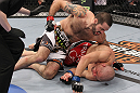 LAS VEGAS, NV - FEBRUARY 04:  Matt Brown (white shorts) attempts to finish Chris Cope during the UFC 143 event at Mandalay Bay Events Center on February 4, 2012 in Las Vegas, Nevada.  (Photo by Nick Laham/Zuffa LLC/Zuffa LLC via Getty Images) *** Local Caption *** Chris Cope; Matt Brown
