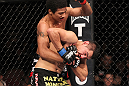 LAS VEGAS, NV - FEBRUARY 04:  Alex Caceres (top) delivers punches to Edwin Figueora during the UFC 143 event at Mandalay Bay Events Center on February 4, 2012 in Las Vegas, Nevada.  (Photo by Nick Laham/Zuffa LLC/Zuffa LLC via Getty Images) *** Local Caption *** Alex Caceres; Edwin Figueroa