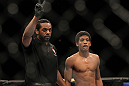 LAS VEGAS, NV - FEBRUARY 04:  Referee Herb Dean (left) deducts two points from Alex Caceres after a series of low blows in his fight against Edwin Figueroa during the UFC 143 event at Mandalay Bay Events Center on February 4, 2012 in Las Vegas, Nevada.  (Photo by Josh Hedges/Zuffa LLC/Zuffa LLC via Getty Images) *** Local Caption *** Herb Dean; Alex Caceres