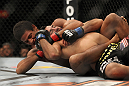 LAS VEGAS, NV - FEBRUARY 04:  Alex Caceres (left) attempts to submit Edwin Figueroa during the UFC 143 event at Mandalay Bay Events Center on February 4, 2012 in Las Vegas, Nevada.  (Photo by Josh Hedges/Zuffa LLC/Zuffa LLC via Getty Images) *** Local Caption *** Alex Caceres; Edwin Figueroa