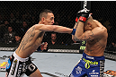 LAS VEGAS, NV - FEBRUARY 04:  Max Holloway (left) punches Dustin Poirier during the UFC 143 event at Mandalay Bay Events Center on February 4, 2012 in Las Vegas, Nevada.  (Photo by Nick Laham/Zuffa LLC/Zuffa LLC via Getty Images) *** Local Caption *** Max Holloway; Dustin Poirier